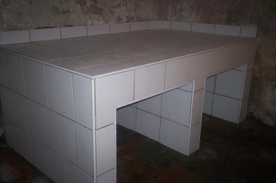 Met het metselen van een bok in de kelder heeft u de optie om wel de gewenste opvoerhoogte te behalen