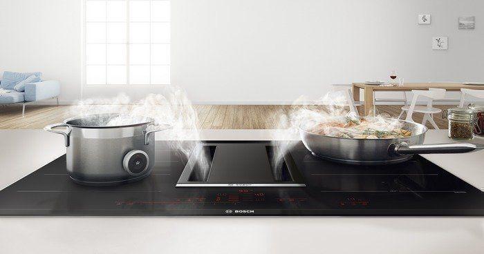 De beste oplossing is de inductie kookplaat met geïntegreerde afzuigkap. Deze 2-in-1 oplossing is naadloos en functioneert uitstekend