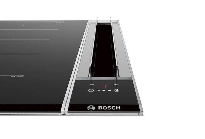 Een aparte geïntegreerde afzuigkap geplaatst naast een domino inductie kookplaat (dus 2 apparaten)